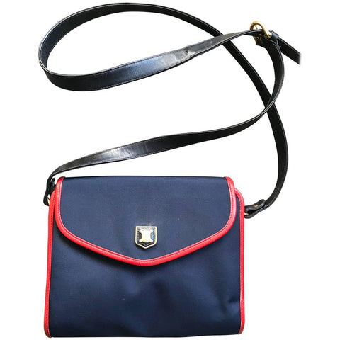 Vintage Celine navy nylon and red leather piping shoulder bag with golden blason macadam logo embossed motif on flap. riri zipper