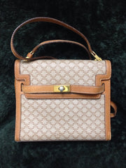 Vintage Celine beige and brown blason macadam pattern mini handbag with brown leather trimmings in Kelly style. Classic shoulder purse