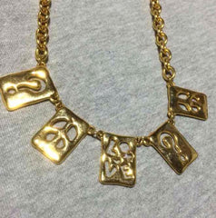 MINT. Vintage Moschino chain statement necklace with square plate with cut out question mark, love and peace mark charms. Moschino BIJOUX