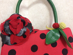 MINT Condition. Vintage MOSCHINO red and black canvas polkadot kelly handbag with a matching rose flower and leaf and crochet fruits motifs