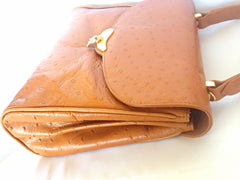 MINT. Vintage Nina Ricci tan brown ostrich-embossed leather handbag purse with golden motif at closure. Masterpiece by Maroquinerie