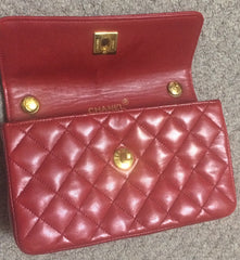 Vintage CHANEL classic mini flap 2.55 shoulder bag in lipstick red lambskin with golden CC and chain strap. Popular purse back in the era.