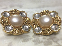 Vintage CHANEL gold tone earrings with a faux pearl, crystal stones, and CC motifs. Great and rare Chanel vintage gift.