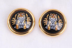 Vintage Hermes cloisonne golden round earrings with female lion design on white and light grey. Great gift idea