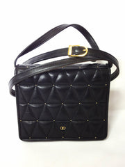 Vintage Valentino Garavani black leather shoulder purse with triangle geometric diamond quilted stitches.