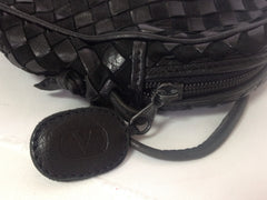 Vintage Valentino Garavani black intrecciato mini pouch style shoulder bag with V logo embossed pull. Classic purse.