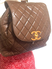 Vintage CHANEL quilted brown lamb leather backpack with gold chain strap and large CC closure. Classic and popular bag. Rare masterpice.