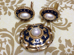 Vintage Burberry faux pearl, crystal stones, and gold and navy tone detailed design brooch and earrings set. Rare Burberry masterpiece