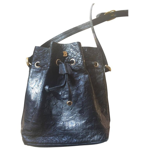 80's vintage BALLY genuine black ostrich leather hobo bucket shoulder bag with golden B logo and drawstrings.