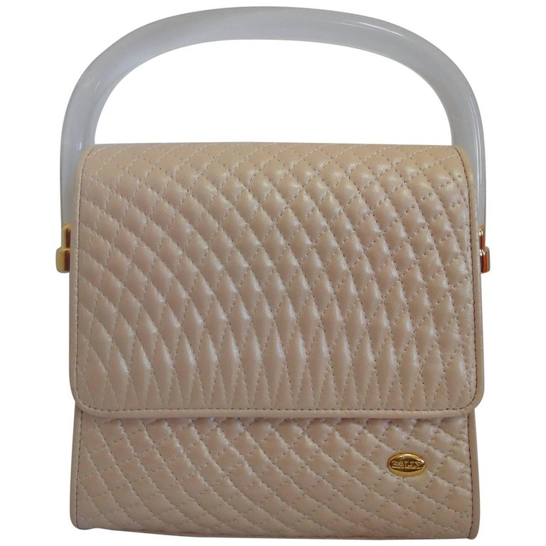 Vintage Bally pearl pink color lamb quilted leather purse with clear plastic handle with golden logo motif. Can be shoulder bag.