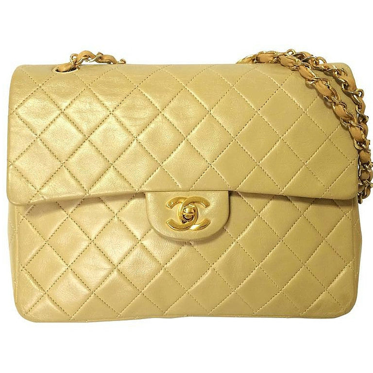 Vintage CHANEL beige color lambskin double flap 2.55 shoulder bag with golden chain strap. Must have medium size purse.
