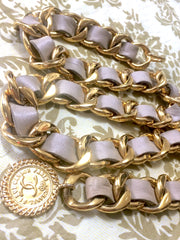 80's Vintage CHANEL beige leather thick chain belt with golden CC and mademoiselle charm. Nice and heavy single layer belt from CHANEL.