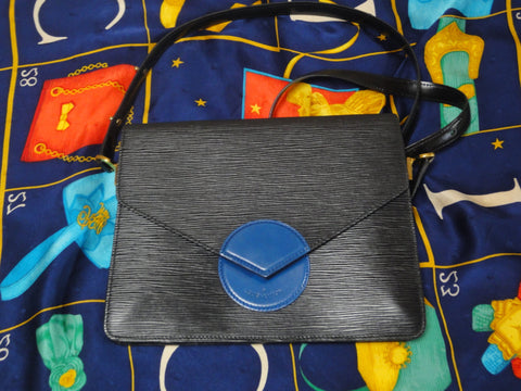 SOLD OUT: Vintage  Louis Vuitton rare epi mod purse with blue beak flap. very chic and mod Has a red version too.