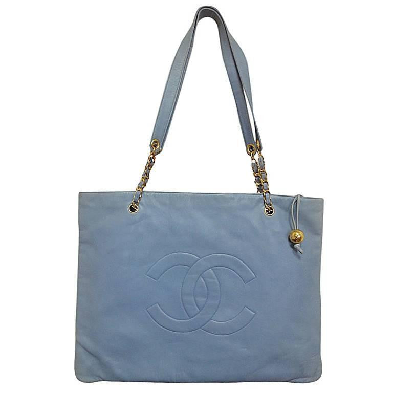 Vintage CHANEL milky blue calf leather extra large chain shoulder tote bag with gold tone CC ball motif. Rare color purse. Limited edition