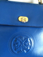 Vintage FENDI blue leather classic kelly style handbag with iconic Janus medallion embossed motif at front.
