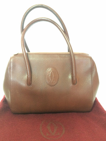 Vintage Cartier classic brown leather handbag with logo mark. les must de Cartier collection.