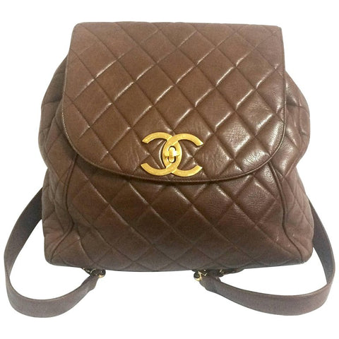 3b8276f9f531 Vintage CHANEL quilted brown lamb leather backpack with gold chain strap  and large CC closure.