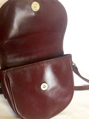 Vintage Burberry wine leather mini pouch shoulder bag with gold tone logo motif at front and khaki check fabric inside.