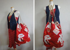 Vintage CHANEL red and white canvas large chain shoulder tote bag with supermodel and 2.55 bag print and CC charm.  Mademoiselle print. Must-have collection