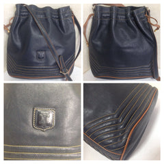 Vintage Celine navy leather hobo bucket shoulder bag with drawstrings and brown pipings. Unisex daily use purse