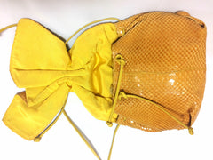 Vintage Carlos Falchi genuine yellow snakeskin shoulder bag in unique round form. Can be pouch too.