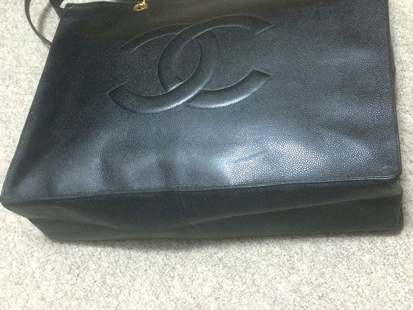 39ac1e01e23a ... Vintage CHANEL black caviarskin extra large tote bag with gold tone  chain handles and CC motif ...