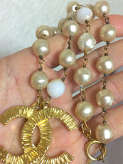 Vintage CHANEL white cream faux baroque pearl necklace with large CC mark pendant top. Classic design jewelry from 80's.