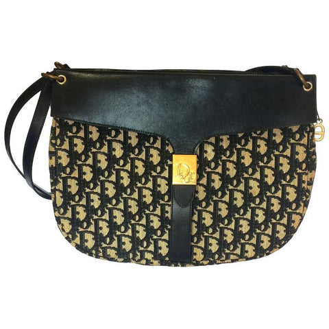 80's vintage Christian Dior navy leather and trotter jacquard shoulder bag with gold tone logo closure. Classic bag from Modele Exclusif.