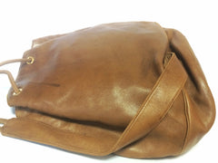 Vintage Christian Dior brown genuine nappa leather backpack design, large hobo bucket shoulder bag with golden logo. Unisex