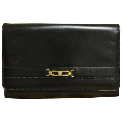 Vintage Celine black calfskin leather clutch purse with iconic golden blason macadam charm at front. riri zipper
