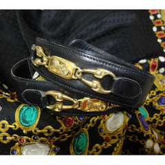 Vintage Celine black leather belt with golden carriage and horse motif. 65 Made in Italy