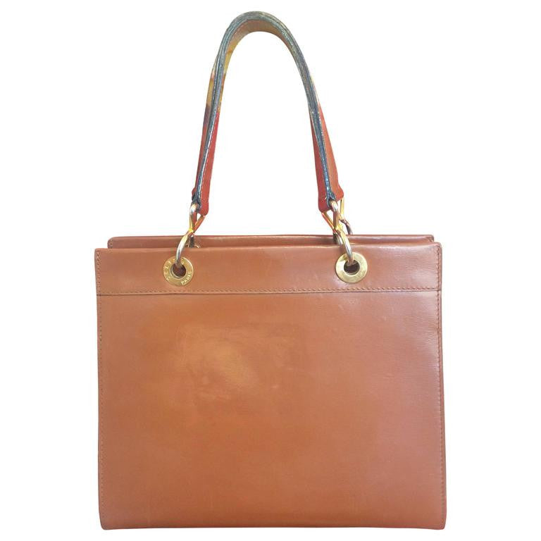 Vintage CELINE brown classic square tote bag with gold tone chains and logo embossed brasses.