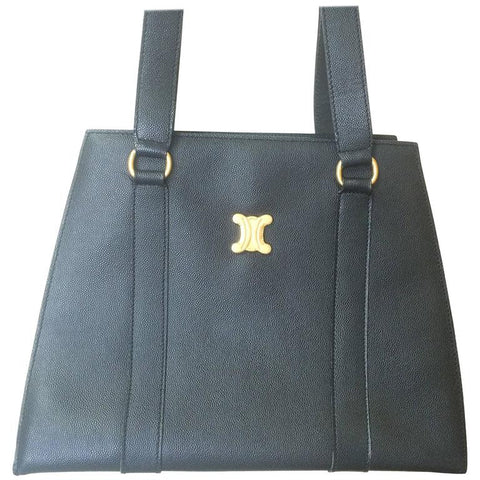 Vintage CELINE black trapezoidal tote with red lining and gold tone Celine logo charm.