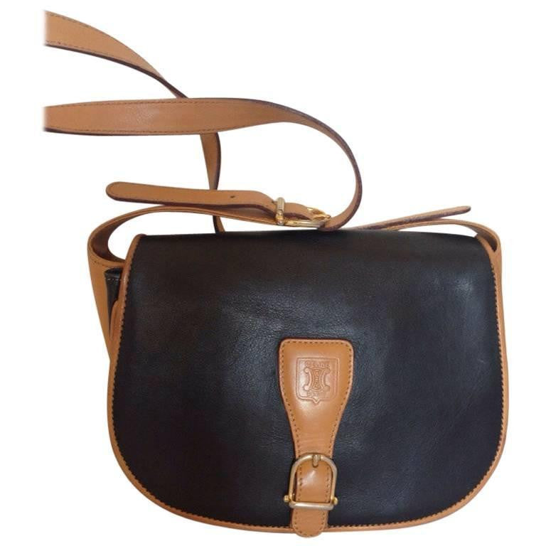 a66021767bfd Vintage Celine black and brown genuine leather shoulder bag with an  embossed logo and gold tone. Sale