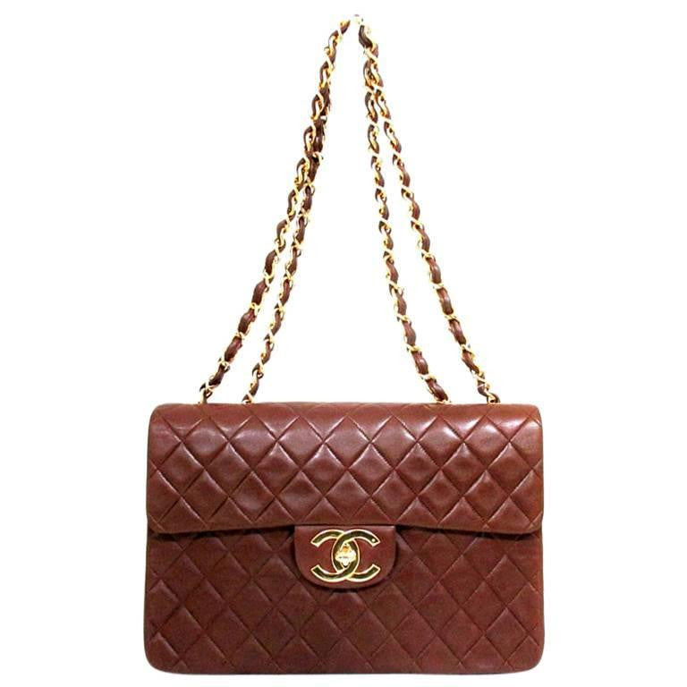 Vintage CHANEL brown lamb extra large, jumbo , classic flap shoulder bag with golden CC closure. 2.55 classic purse.