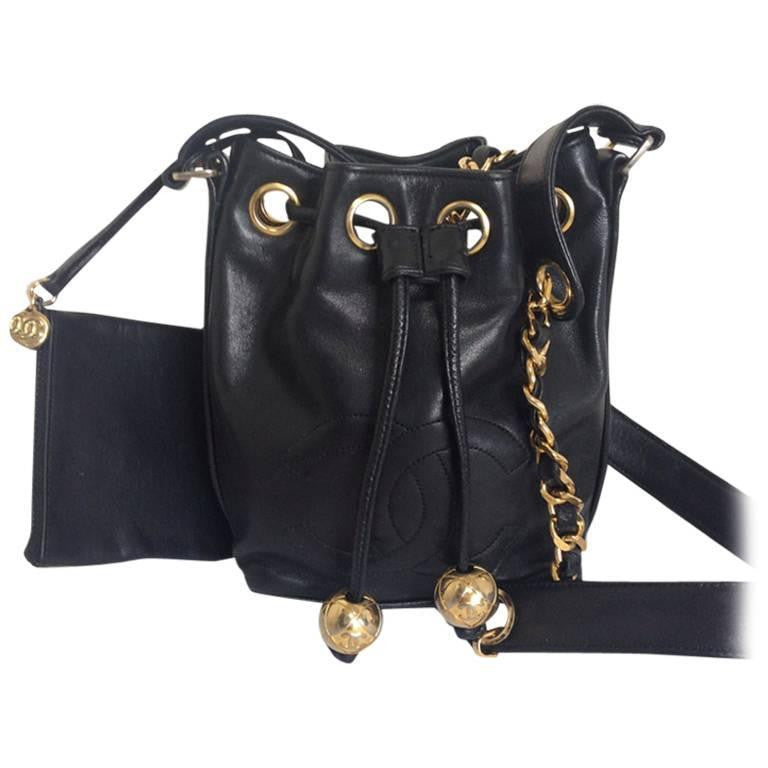 e270bf57ccdbfa Vintage CHANEL black lamb leather mini hobo bucket drawstring shoulder bag  with golden ball charms and