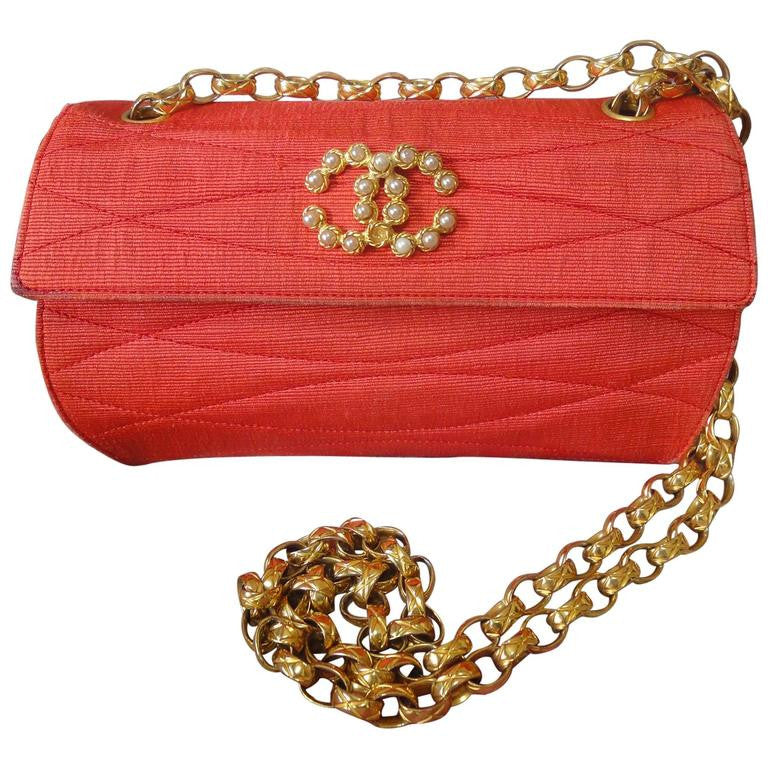Vintage CHANEL lipstick red orange silk and gold leather purse with round quilting stitches, golden chain strap, and faux pearl CC motif.