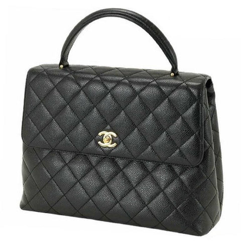 Vintage CHANEL black caviar leather kelly handbag with golden CC closure. Classic purse