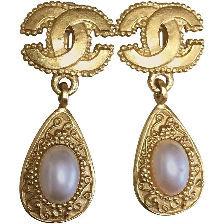 Vintage CHANEL teardrop shape dangling earrings with faux pearl and CC mark. Rare, one-of-a-kind Chanel jewelry.