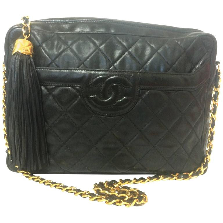Vintage Chanel black large 2.55 camera bag style chain shoulder bag with fringe and CC stitch mark. Classic daily purse.