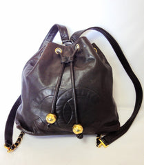 Vintage CHANEL dark brown lamb leather hobo bucket style chain strap backpack with CC mark and golden ball charms. Rare and must have bag