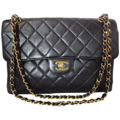 Vintage CHANEL black lambskin 2.55 classic jumbo, large shoulder bag with double side flap and golden CC closure