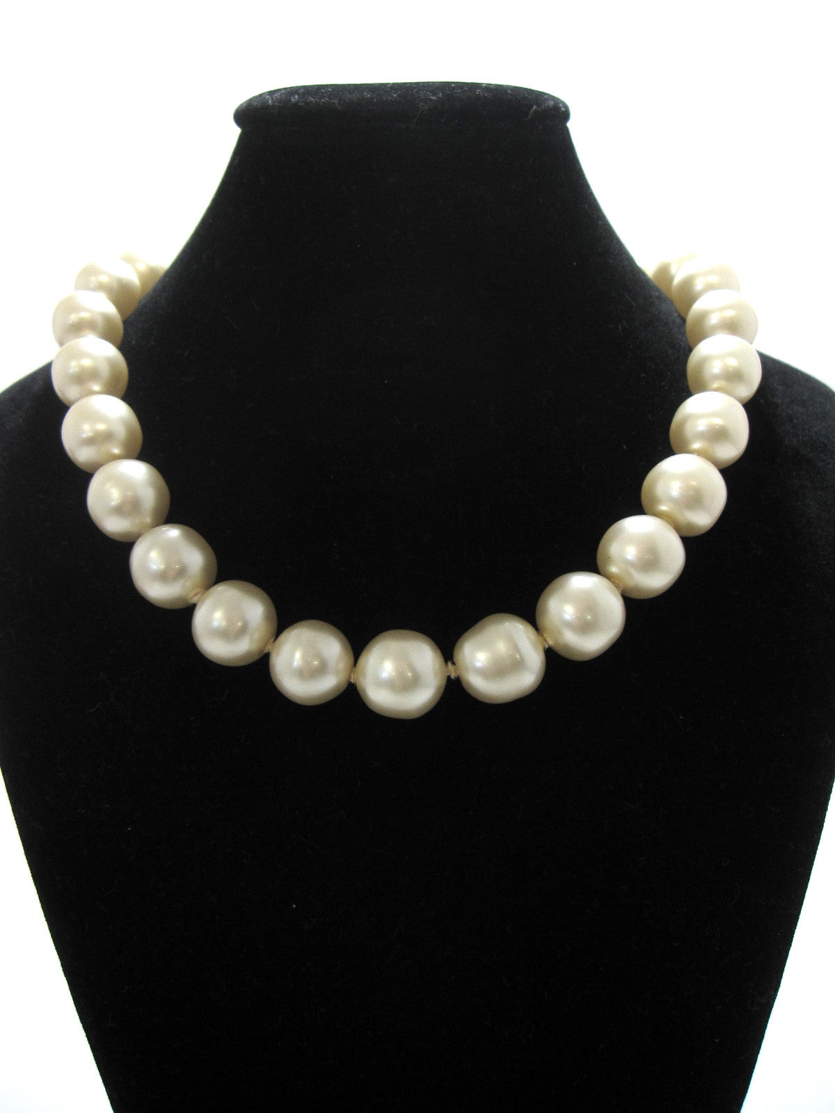 SOLD OUT: Vintage CHANEL large classic faux pearl necklace with golden closure with an embossed logo. Classic jewelry piece for any season