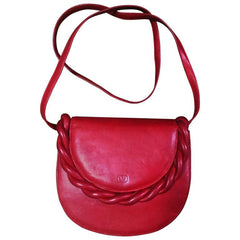 Vintage Valentino Garavani deep cherry red leather shoulder bag with twist motif and V embossed logo.