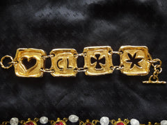Vintage Christian Lacroix gold tone extra large statement bracelet with clover, star, heart, and CL charms. Gorgeous masterpiece