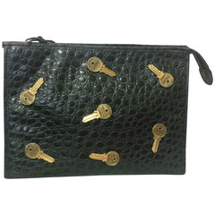 Vintage MOSCHINO classic croc-embossed black leather clutch bag with key logo motifs all over. Masterpiece produced by Red Wall