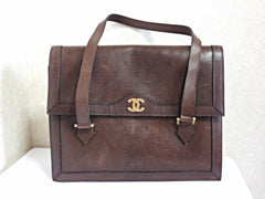 70s, 80s vintage CHANEL cocoa brown calfskin handbag with gold tone CC motif and mini CC motifs allover. Rare masterpiece  back in the era.