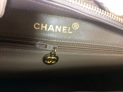 Vintage CHANEL cocoa brown caviar leather chain shoulder bag with golden sun flower CC mark charm. Classic bag