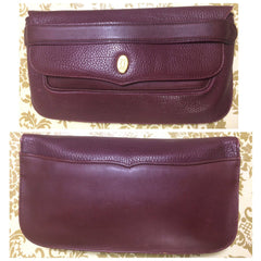 Vintage Cartier leather wine color clutch with gold tone charm. must de Cartier Collection