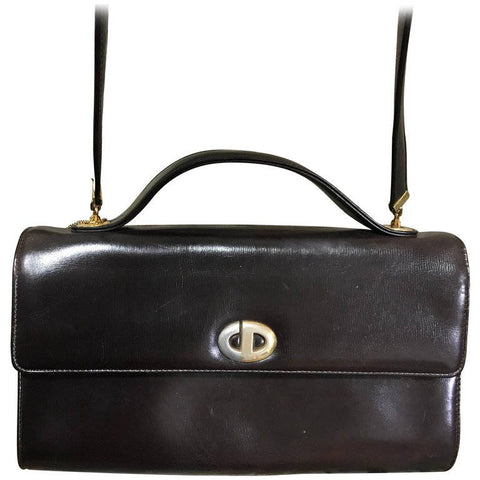 Vintage Christian Dior dark brown leather shoulder bag with silver and golden CD logo motif with a matching kiss lock coin case.